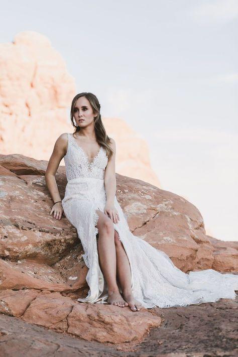 lace fit and flare wedding dress with front split and a deep V-neckline Kip Allen Photography #UtahBride #UtahWedding #BitsyBridal #NewYorkBridalFashionWeek #NYFW #FashionWeek #MadiLane