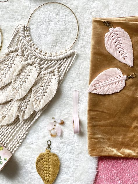 These sophisticated macrame wall hangings are the perfect addition to your boho decor. Their lovely texture and fluffy feathers add such a beautiful detail to your wall. And – I just love the gold ring, it's all in the pretty details.