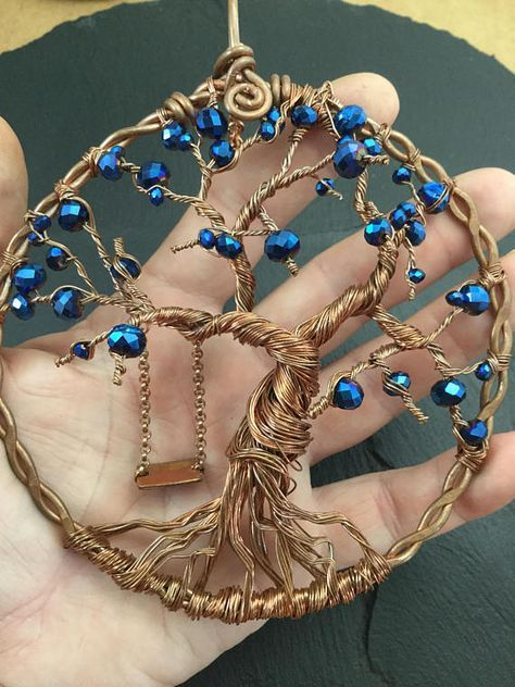 One of the cutest wire tree of life sun catcher design ever , entirely created and designed from recycled copper wires it is a good way to embellish your yard or home and also being environmentally friendly. Every detail of the tree itself are meticulously wrapped shaped by hand from dozens of thin raw copper wire strands , both 26 and 24 gauge. The frame is made of 2 12gauge strands twisted together then hammered flat for sturdiness. The beads are a mix of high quality faceted midnight blue...