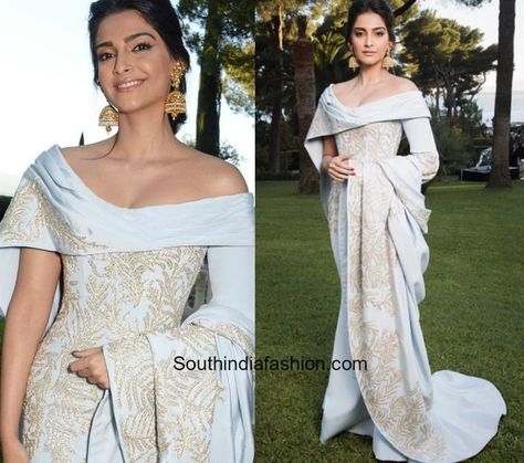 Sonam Kapoor attended the Amfar Gala at Cannes wearing a gold embellished gown in powder blue by Ralph & Russo.