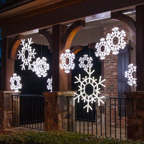 Hang snowflakes across the porch for Christmas.