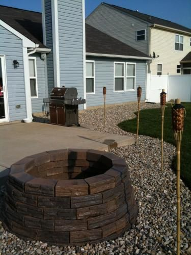 Fire Pit In Bed Of Rocks Concrete Wall Flagstone