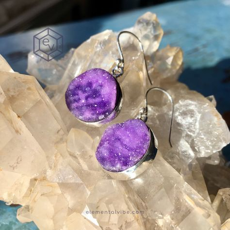 The term druzy refers to a small mass of crystals that form on the surface of another stone. A druzy forms when water brings minerals onto a rock's surface. When the water evaporates, cooling occurs and the minerals are left behind to form crystals. There are many different types of druzy, because there are many types of minerals. These babies are quartz. #druzy #crystalearrings #purplejewelry #druzyjewelry #bohostyle