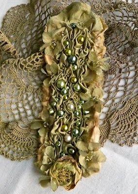 Soft sculpture wristlet by  Pat Brennan