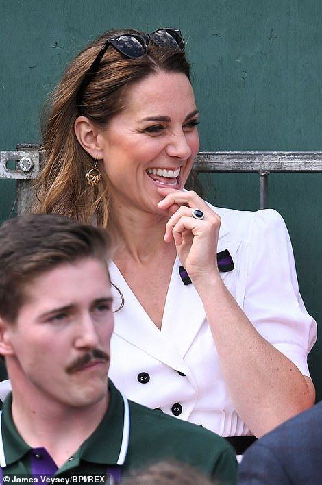Kate appeared very happy to be watching the tennis, giving a cheeky giggle as she flashed her famous engagement ring