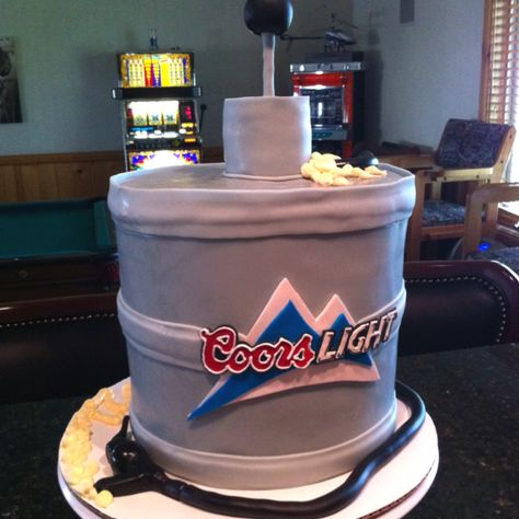 Coors light keg Cake!!  If your man likes Coors this would be a cool groomsmen cake!