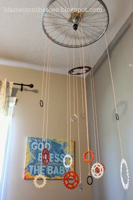 DIY Mobile made of bicycle parts (wheel and gears). Orange and Gray Vintage Bicycle Nursery