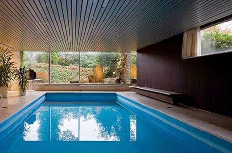 desain rumah dengan kolam renang indoor komtemporer