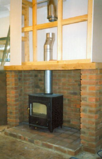 Clearview Vision 500 woodburning stove with false chimney breast under construction. This twinwall f