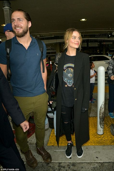 Loved up!Margot Robbie and Tom Ackerley looked closer than ever, as the pair walked throu...