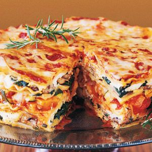 Mile-high meatless lasagna pie. 450 calories per serving. This layered beauty is stacked with fresh vegetables, baby greens, aromatic herbs, three kinds of Italian cheeses, and a rich, hearty tomato-basil sauce. It's ideal for a special-occasion dinner.