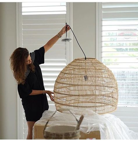 UNVEILING | this beauty! Handwoven wicker pendant. She's a keeper (Mel's not bad either! ). Our @hkliving pendant ready for install @webbandbrownneaves new display home with interiors by this clever woman @melissaredwoodinteriordesign