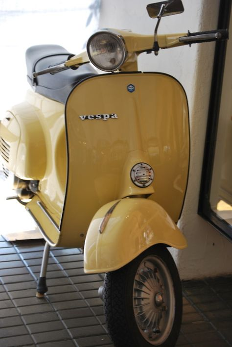 I would love a little yellow vespa.  I would love even more to live somewhere where this is practical transportation :)