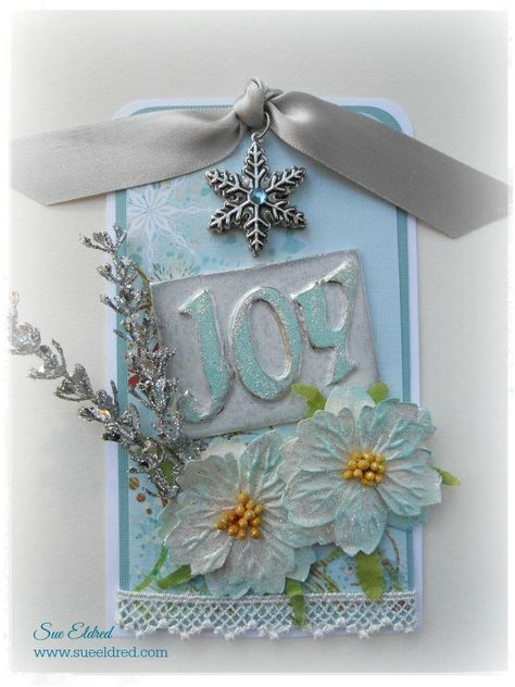 You'll want to make a stop at the Hardware Store for this one. The Joy used on this tag was made using the foil tape found in the hardware store. You know the kind the heating and cooling guys use to seal ductwork. A fun technique with cool results. Start with a small piece of matboard or chipboard approx. 2 x 2 1/2 and chipboard letters spelling the word Joy.I also used:[list][*] Beacon Adhesives Zip Dry Paper Glue*[/*][*]Decocolor pens in white and pale blue[/*][*] Aluminum Foil…