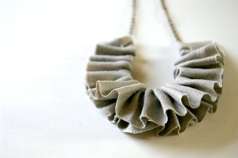 Linen in a lovely shade of grey is threaded and cinched to make a dainty little ruffle with mega texture. An antiqued bronze chain gives this necklace some vintage charm.  Necklace measures about 20 from end to end. it is adjustable and can be lengthened upon request. Fabric is sealed to prevent fraying.  Necklaces are made-to-order. because of their handmade nature, each necklace may vary slightly from the one pictured.  Available in the following colors (pictured in last photo) :: {1}…