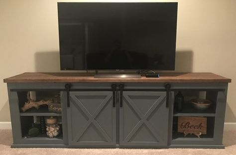 Inspired by Ana White, this sliding door entertainment center is a great combination of rustic and practical for any room you are looking for. #slidingdoorentertainmentcenter #entertainmentcenter #diyfurniture | chiselandfork.com