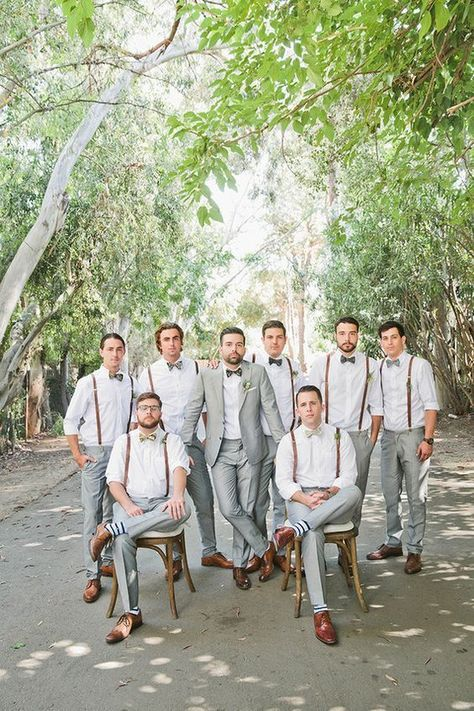 Bohemian Malibu wedding: Groom and groomsmen in suspenders and gray