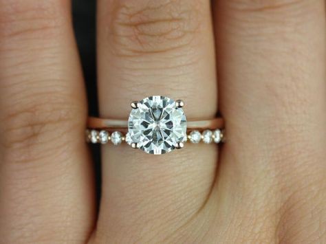 This wedding set is perfect for those who are classics! This clean design is both feminine and practical. It can sit flush against any band! All