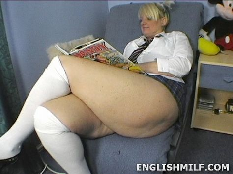 Blonde English woman in school uniform and knee socks showing off her sexy thick bbw thighs and legs. Daniella English MILF videos.