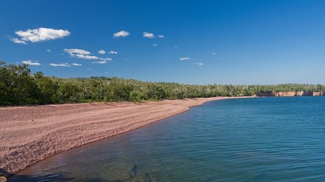 IONA'S BEACH -- 3 miles north of Gooseberry Falls at mile marker 42 -- This is the most musical beach on the North Shore. It's covered with flattened pieces of smooth pink rhyolite, and when waves hit the beach, they fall back into place with the sound of a million bells. Park at Twin Points water access.