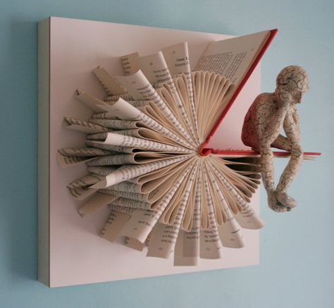 Sliced book wall art with thinking man