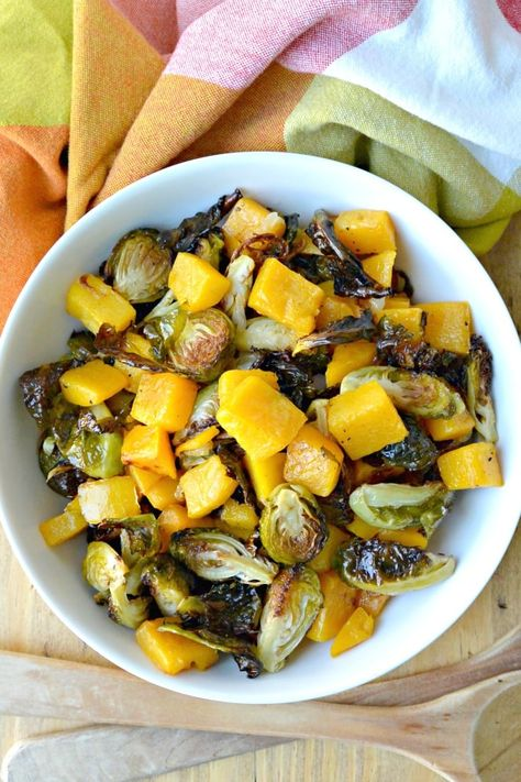 Roasted Brussels Sprouts & Butternut Squash combines two favorite vegetables in a delicious easy side dish. This healthy recipe is vegan and gluten-free. #brusselssprouts #butternutsquash #roastedvegetables #sidedish #vegetables #vegan #vegetarian #glutenfree #healthy #recipe #thanksgiving