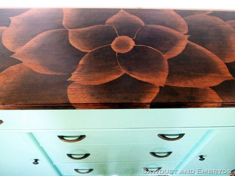 Stained flower on buffet top