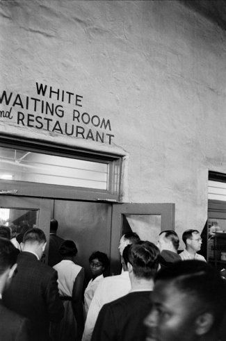 edom Riders enter a bus terminal area designated as whites-only in Jackson, Mississippi, in 1961. They were promptly arrested on charges of breaching the peace and disobeying an officer.