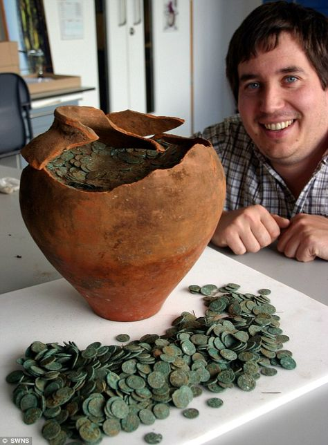 10,000 Roman coins unearthed by amateur metal detector enthusiast... on his first ever treasure hunt