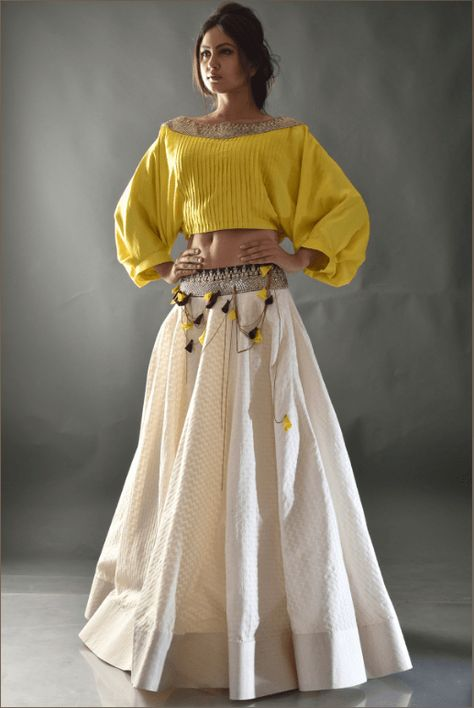 Yellow Beige Sequins Crop Top Lehenga Price: INR Get set to sparkle with beige coloured cotton lehenga. The lehenga comes with woven texture all over the base and shimmering embroidery on th…