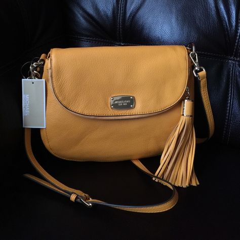 a65f90d50425 Michael Kors leather handbag Michael Kors Bedford Medium Tassel Convertible  Shoulder Bag Color: Vint Yellow features a pair of optional shoulder straps.