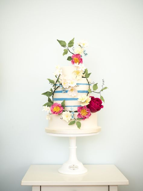 Beautiful floral wedding cake. Bright and bold (large statement with roses and peonies) and more organic arrangements as well