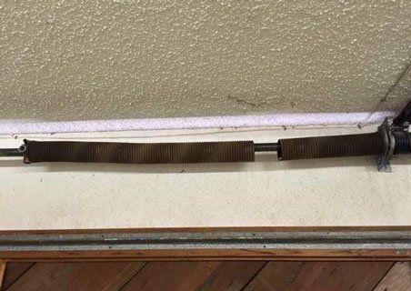 Garage Door Repair Spokane With The Latest On Broken Garage Door Springs What Causes Garage D Broken Garage Door Broken Garage Door Spring Garage Door Springs