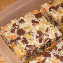 "Magic Cookie Bars from EAGLE BRAND® ""This bar cookie is an old fashioned favorite. Chocolate chips, nuts and coconut are set in a caramelized layer on top of a graham cracker crust. Mini Desserts, Easy Desserts, Delicious Desserts, Yummy Food, Coconut Desserts, Best Desserts To Make, Easy Dessert Bars, Easy Chocolate Desserts, Coconut Recipes"