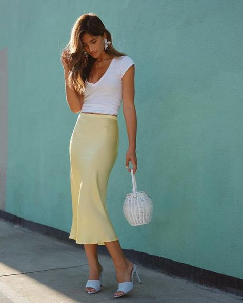 We have a lemon silk satin bias slip skirt almost as the one seen on stylish Rocky Barnes. Outfit idea