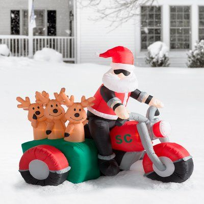 The Holiday Aisle Christmas Inflatable Santa Claus Driving Motorcycle with 3 Reindeer Decoration