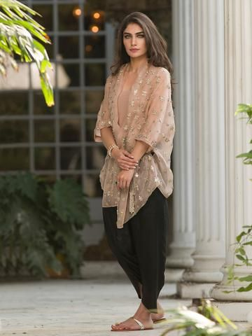 Cut from breezy cotton net, this Naryman kurti is embellished in a diamond pattern with a score of techniques. Paired with a versatile dhoti shalwar making this