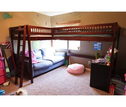 double loft beds perfect for the kids who are sharing a room. One  modification a small double sides bookshelf between the two beds for  storage and