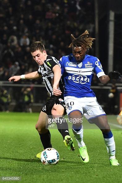 02-26 Angers' French midfielder Baptiste Santamaria (L)... #saintandrews: 02-26 Angers' French midfielder Baptiste… #saintandrews
