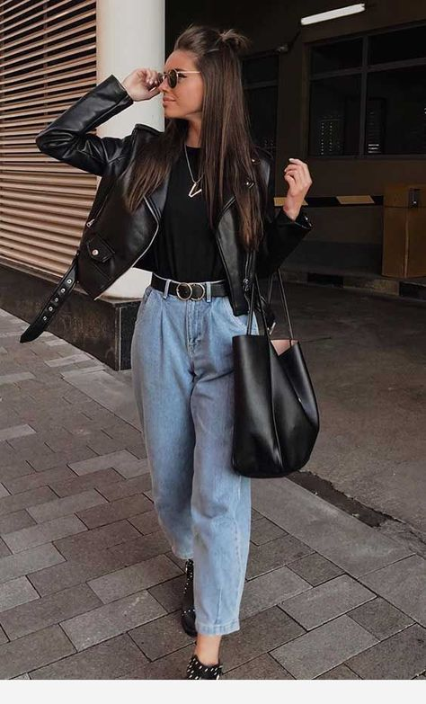 Superb outfit with blue jeans and black top