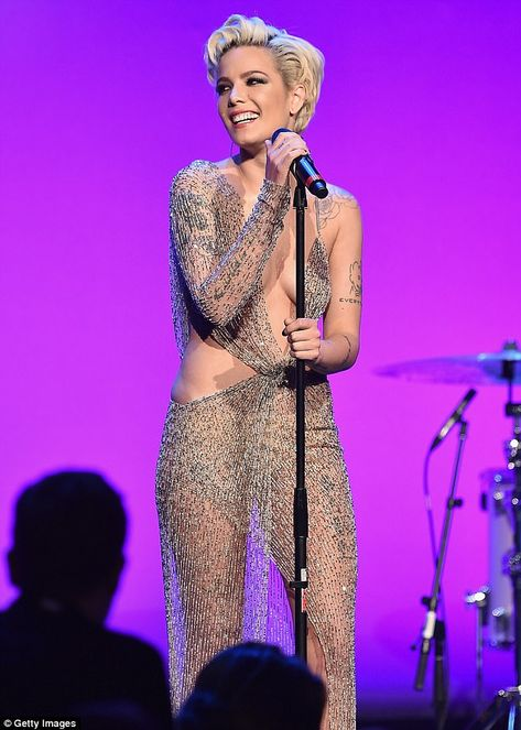 All smiles: Halsey - real name Ashley Nicolette Frangipane - stepped on stage in a beige beaded see-through gown that featured a plunging neckline and cut-outs at the waist
