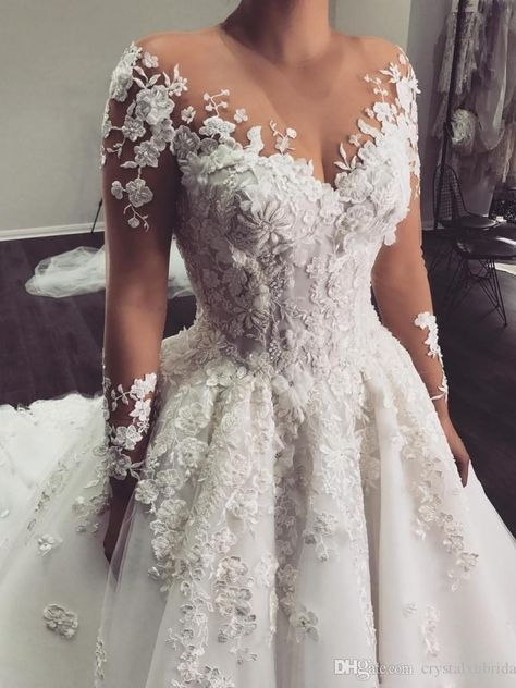 Custom Long Sleeve Wedding Gowns You Can Afford - - This sheer long sleeve can be recreated for you with any design preferences. We are dress makers who produce custom and of couture designs for less. Source by darius_custom_wedding_dresses Sheer Wedding Dress, Wedding Gowns With Sleeves, Long Sleeve Wedding, Dream Wedding Dresses, Bridal Dresses, Lace Dress, Wedding Dress Uk, Different Color Wedding Dresses, Long Sleeved Wedding Dresses