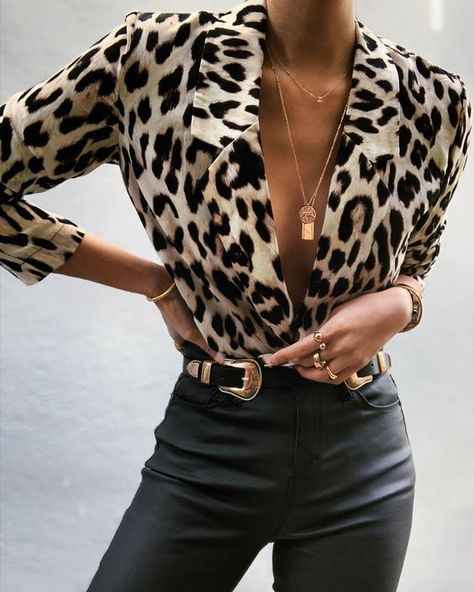 Gold jewellery Gold necklace Gold rings Leather pants Leopard blouse B