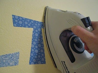Didn't know you could iron fabric onto the wall? Just as easy as vinyl! Peels right off.... Say what?!? {NO I didn't know that!!}