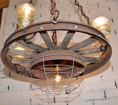 Household items made of car parts steering wheel chandeliers repurposed antique automobile wheel chandelier farmhouse chic automobile collectors country home aloadofball Gallery
