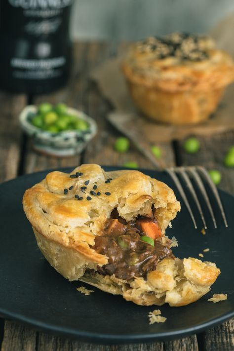 These Guinness Irish Beef Stew Mini Pot Pies from The Road to Honey are the ultimate comfort food. Classic Irish Beef Stew with melt-in-your-mouth beef in a rich and hearty gravy is placed in a buttery, flaky crust! Irish Recipes, Pie Recipes, Dinner Recipes, Cooking Recipes, Irish Meat Pie Recipe, Mini Beef Pot Pie Recipe, Recipies, Irish Meals, Scottish Recipes