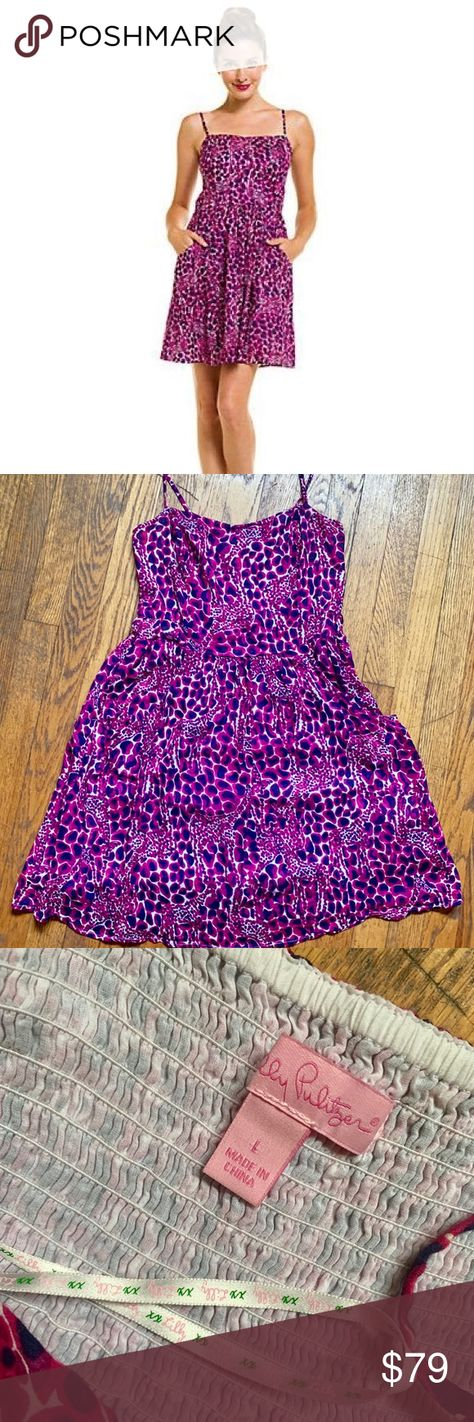 "Lilly Pulitzer ""Anna Lynne"" Gigi Giraffe Dress L Washed and worn 2-3x. I don't see any signs of wear... just been sitting in my closet. Dress is an adorable giraffe/animal print in shades of pink, purple and navy. Adjustable strips and a smocked back... dress has a little room to move if you're busty. Dress also has pockets! Lilly Pulitzer Dresses"