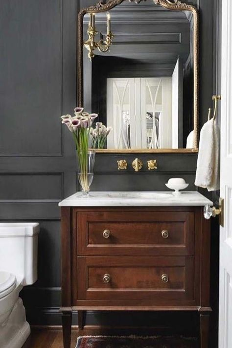 Traditional bathroom 395261304793179015 - Powder room This chic and classic powder room features a custom furniture-looking vanity with white marble countertop and floor-to-ceiling paneling, painted in a custom charcoal stain color Source by Powder Room Small, Powder Room Vanity, Traditional Bathroom, Bathroom Decor, White Marble Countertops, Powder Room Design, Bathroom Furniture, Home Decor, Bathroom Design