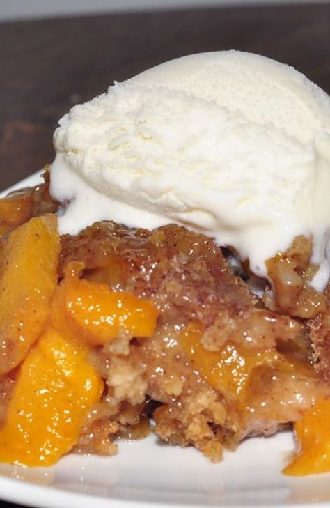 Crock Pot or Slow Cooker Peach Cobbler dessert recipe is best served warm and topped with vanilla ice cream. It's an easy dessert to throw in the crock pot and just let it cook. Everyone loves this! Does this What a great recipe for all of those summer peaches. I'd love to eat some of this after the beach.