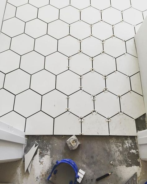 White octagon cement tile in bathroom via Rafterhouse Love the idea of cement hex tile but maybe in dark grey?
